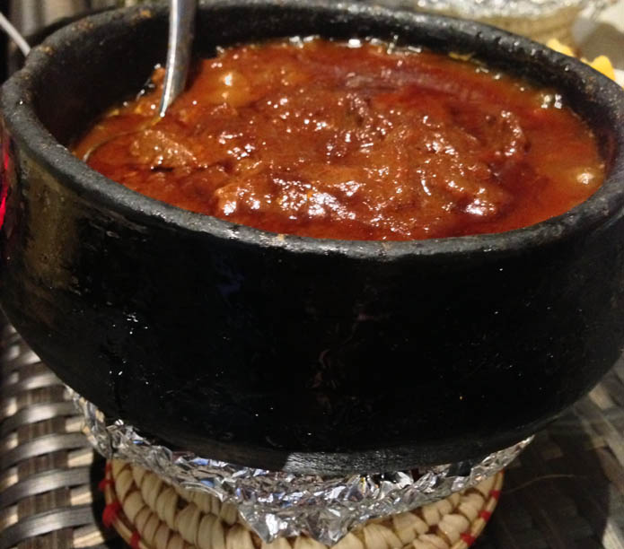 Zigni - Tender stewed lamb served in a spicy tomato based sauce