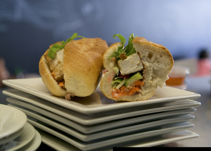 A freshly made banh mi ready to be served