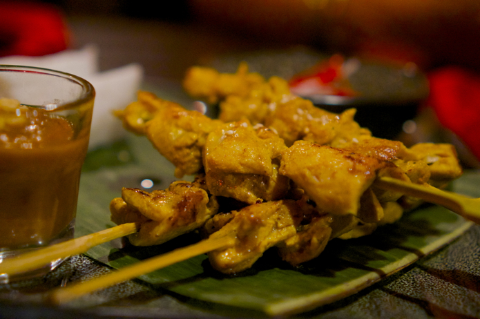 Chicken skewers with a shot glass of intensely flavoursome satay sauce