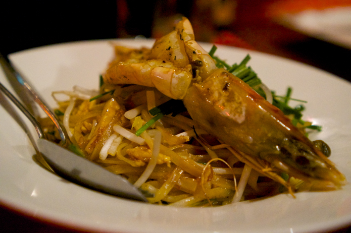 Pad Thai noodles with tofu, egg, peanuts and a tiger prawn