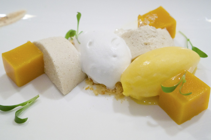 Panna cotta, mango jelly, coconut ice cream, malibu jelly, mango sorbet and a biscuit crumb. Garnished with coriander.