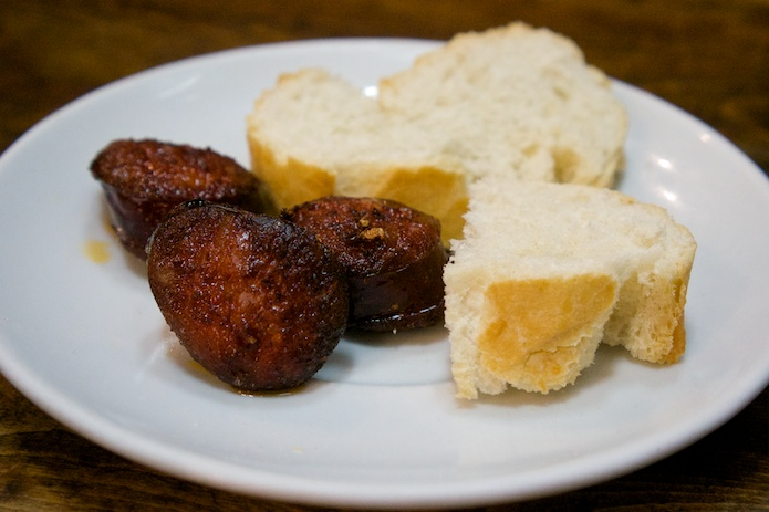 Chorizo and bread at Casa Toni