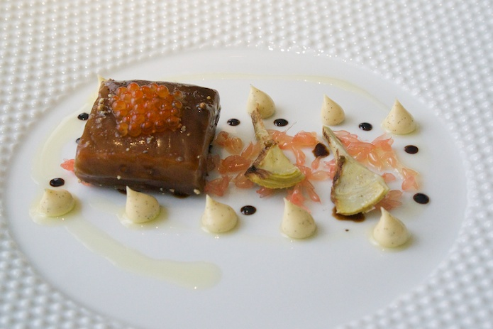 Salmon poached in a liquorice gel with vanilla mayonnaise, trout roe, pink grapefruit and artichokes.