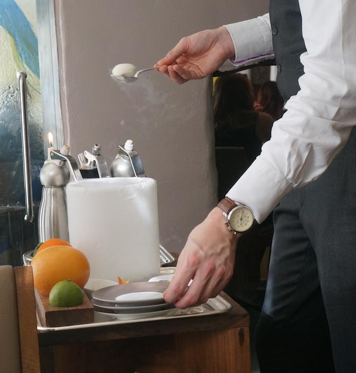 The waiter preparing our nitro-poached aperitif