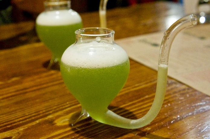 The Genie, Aladdin's Genie - Green Fairy sour with lychee & twin Alize, served in a rather unusual vessel