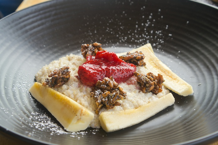 Buckwheat and quinoa porridge, macerated strawberries, back puffed rice, banana and coconut