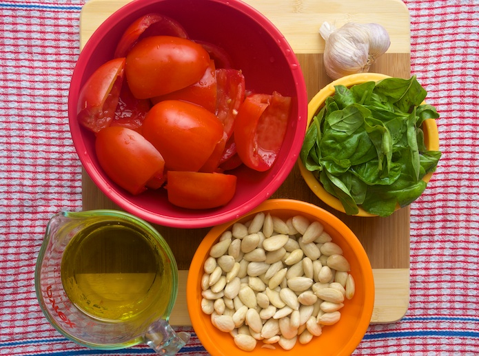 Ingredients for Pesto alla Trapanese - ripe tomatoes, fresh basil, garlic, almonds and olive oil