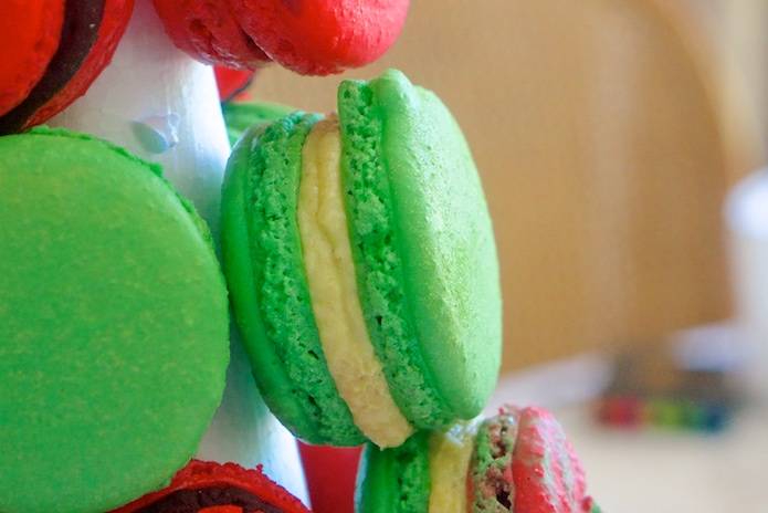 Green Christmas macaron with pistachio buttercream filling