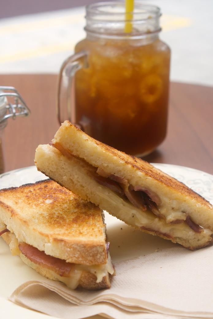 Bacon Badboy (maple bacon, provolone, mozzarella, grilled apple) and a cold brew coffee
